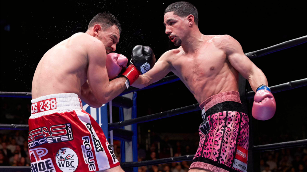 WBC welterweight champion Danny Garcia lands a right hand on Robert Guerrero. Photo: Suzanne Theresa/Premier Boxing Champions