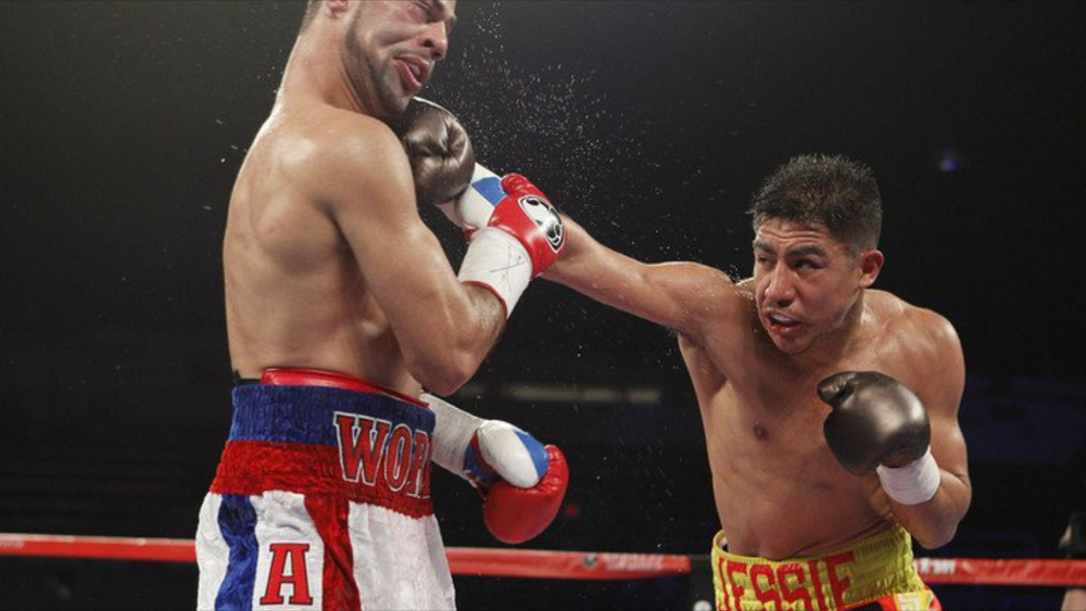 Jessie Vargas lands a right hand on Sadam Ali. Vargas won the vacant WBO title against Ali. Photo: Tom Hogan/Hogan Photos/Golden Boy Promotions