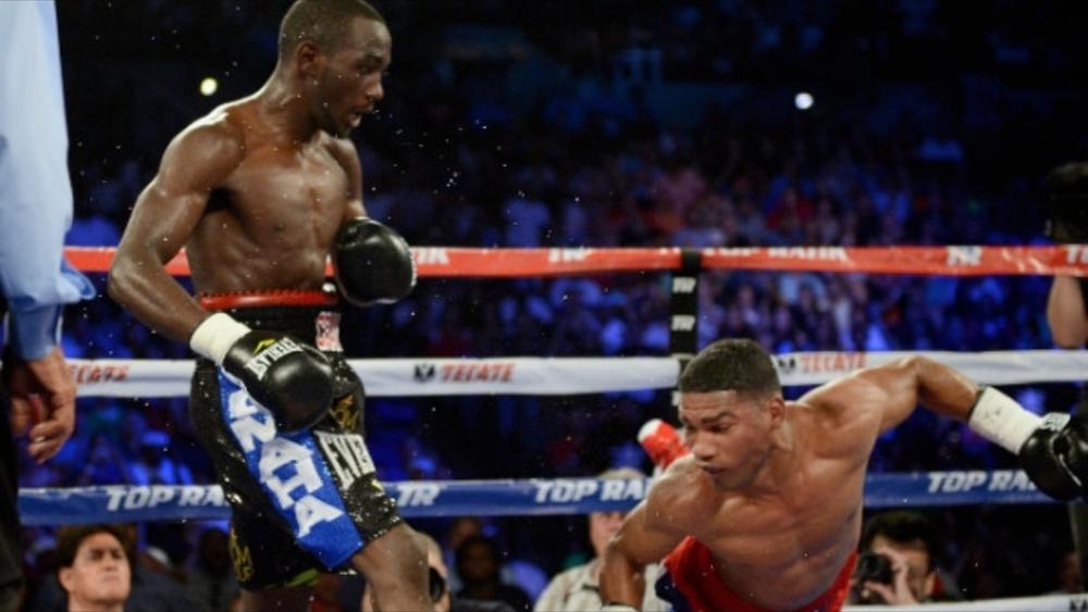 Terence Crawford scoring a knockdown on Yuriorkis Gamboa. Photo: Chris Farina/Top Rank