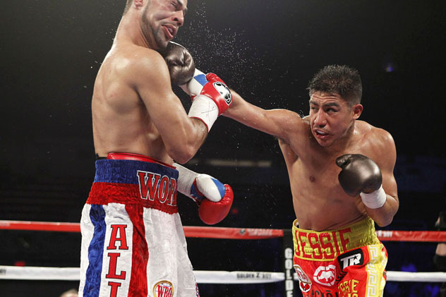 Jessie Vargas lands a right hand on Sadam Ali en route to winning the WBO welterweight title. Photo: Tom Hogan/Hogan Photos/Golden Boy Promotions