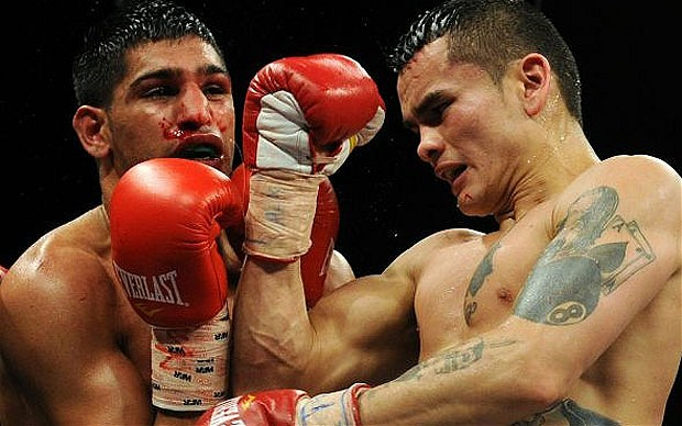 Marcos Maidana lands an uppercut on Amir Khan in their 2010 fight. Photo: Getty Images