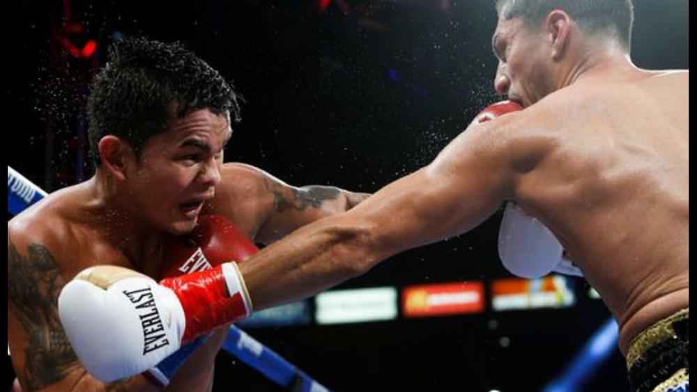 Marcos Maidana lands a left hand on Josesito Lopez. Photo: Esther LIn/Showtime