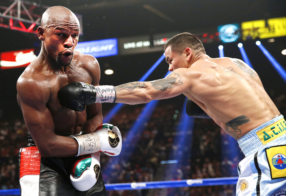 Marcos Maidana lands a left hand on Floyd Mayweather. Photo: Eric Jamison/Associated Press