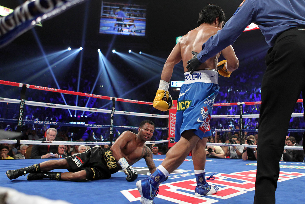 Pacquiao walking to the neutral corner after scoring a knockdown on Shane Mosley in their May 2011 fight. Photo: Tom Casino/Showtime