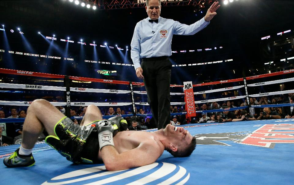 Liam Smith in the 9th round after the final body shot from Canelo Alvarez that ended the bout on September 17, 2016. Photo: LM Otero/Associated Press