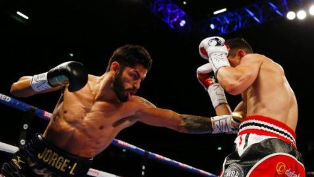 Jorge Linares lands a jab to the body of Anthony Crolla. Photo: Peter Cziborra