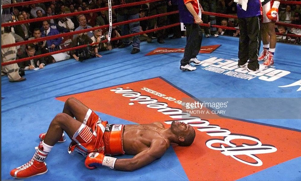 Bernard Hopkins lays in the middle of the ring after his victory over Felix Trinidad. Photo: Timothy A. Clary/Getty Images