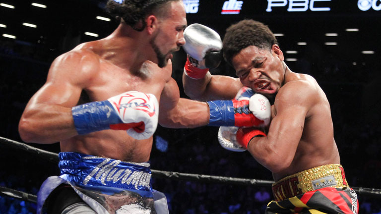 Keith Thurman lands a shot on Shawn Porter in their bout this past June in New York. Photo: Ed Mulholland/Getty Images.