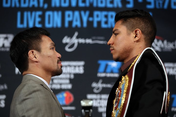 Manny Pacquiao and Jessie Vargas face off at a press conference. Photo: Mikey Williams/Top Rank