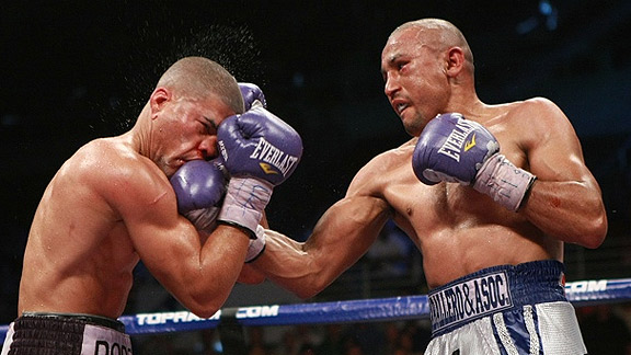 Orlando Salido lands an uppercut on Juan Manuel Lopez in their second fight. Photo: Marco Perez/MPsportsimages.com
