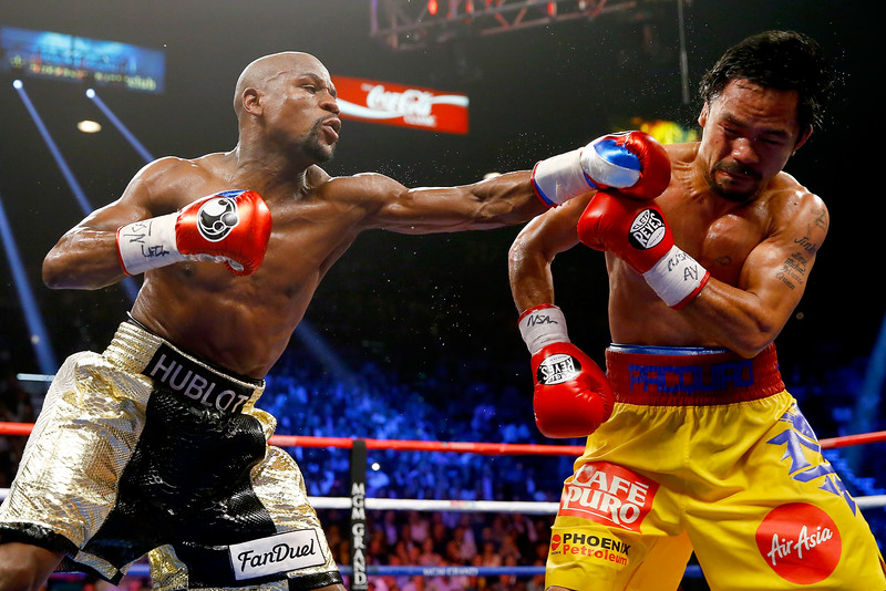 Floyd Mayweather Jr. throws a left at Manny Pacquiao during their world championship bout on May 2, 2015 at the MGM Grand Garden Arena in Las Vegas. Photo: Al Bello/Getty Images.