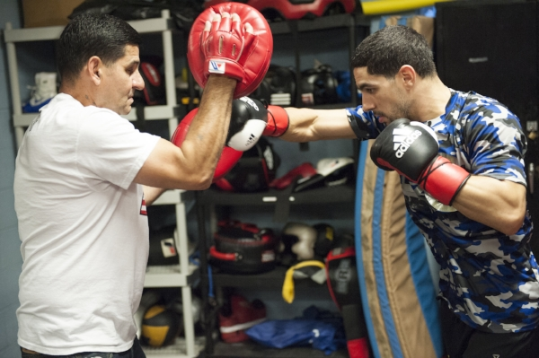 Danny Garcia hits the pads with Angel Garcia his dad and trainer during media day workouts. Photo Credit: Darryl Cobb/King's Promotions/Premier Boxing Champions