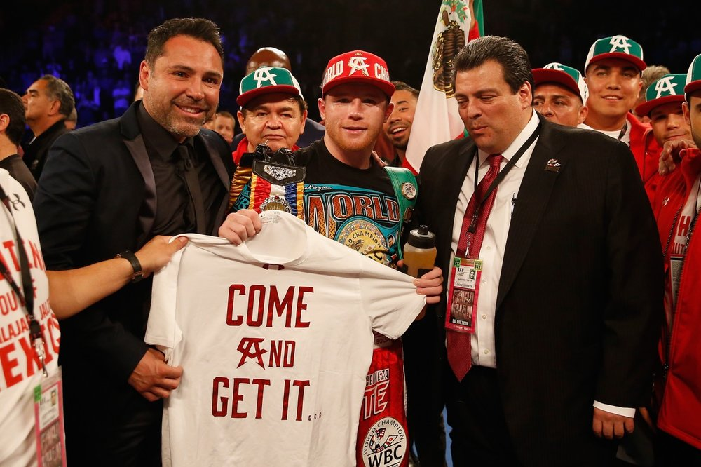 Canelo Alvarez with promoter Oscar De la Hoya and WBC president Mauricio Sulaiman after his victory over Amir Khan in May 2016. Photo: Christian Petersen/Getty Images