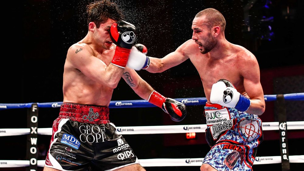 Jose Pedraza lands a right hand on Stephen Smith. Photo: Stephanie Trapp/Showtime