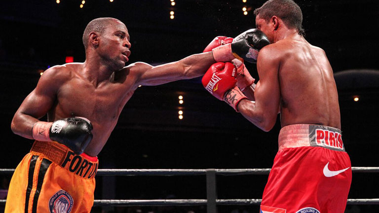 Javier Fortuna lands a left hand on Carlos Velasquez. Fortuna would stop Velasquez in the 10th round. Photo: Lucas Noonan/PBC