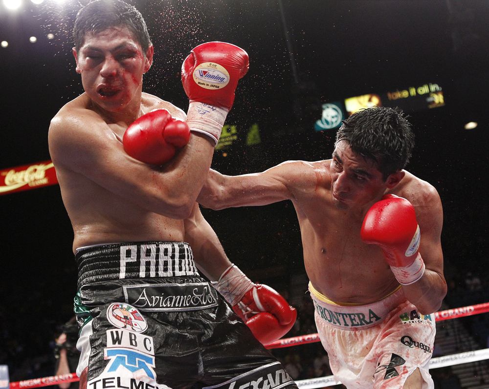 Erik Morales lands a right hand on Pablo Cesar Cano in their September 2011 fight to win the WBC 140-pound title. Photo: John Locher/Las Vegas Review-Journal