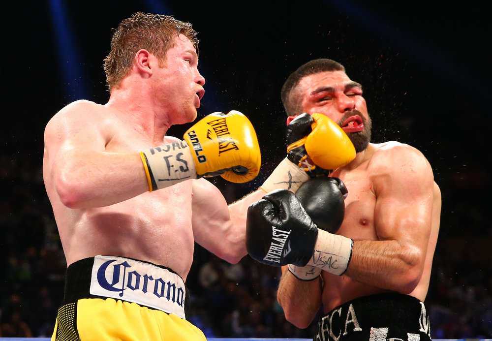 Canelo Alvarez lands a left hook on Alfredo Angulo in March 2014. Photo: Tom Casino/Showtime