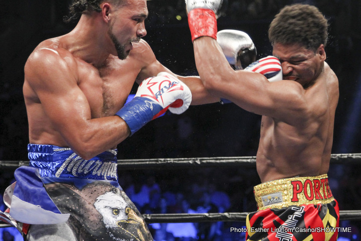 Keith Thurman lands a left hook during an exchange with Shawn Porter in their June 2016 bout. Photo: Esther Lin/Tom Casino/Showtime