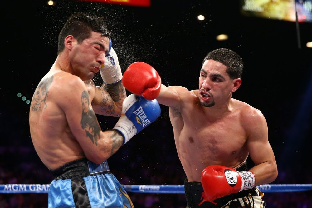Danny Garcia lands a right hand on Lucas Matthysse in their September 2013 fight. Photo: Al Bello/Getty Images