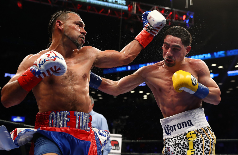 Keith Thurman lands a left hand during an exchange with Danny Garcia. Thurman won a split decision over Garcia to become the unified WBA and WBC welterweight champion. Photo: Al Bello/Getty Images