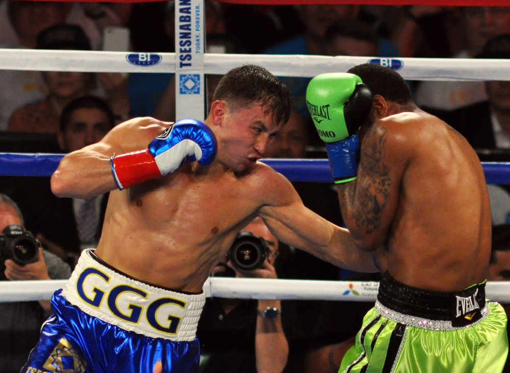 Gennady Golovkin lands a left hook to Dominic Wade's body in their April 2016 middleweight bout. Photo: German Villasenor