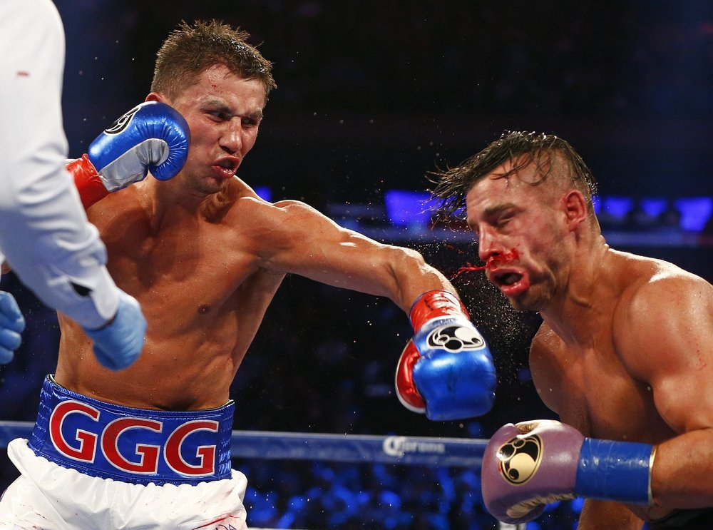 Gennady Golovkin lands a left hook on David Lemieux en route to an eighth-round stoppage victory. Photo: Rich Schultz/AP