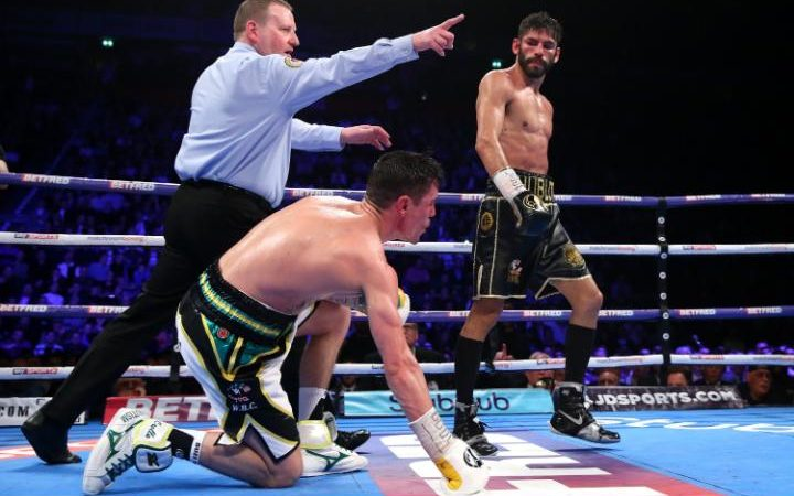 Jorge Linares lands an uppercut on Anthony Crolla in the ninth round dropping him to the canvas. Photo: Getty Images