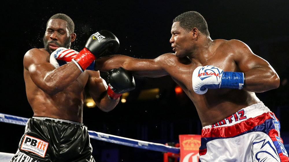 Luis Ortiz lands a right jab on Bryant Jennings. Photo: HBO Sports