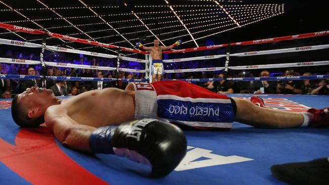 Vasyl Lomachenko stands in the background after his fifth knockout over Roman Martinez. Photo: Rich Schultz/Getty Images