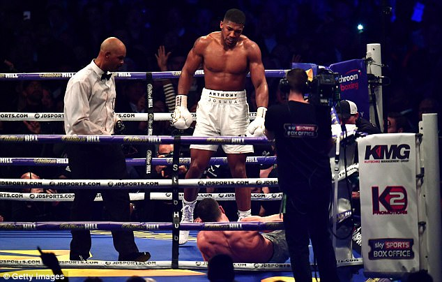 Anthony Joshua stands over Wladimir Klitschko in the eleventh round. Photo: Dan Mullan/Getty Images
