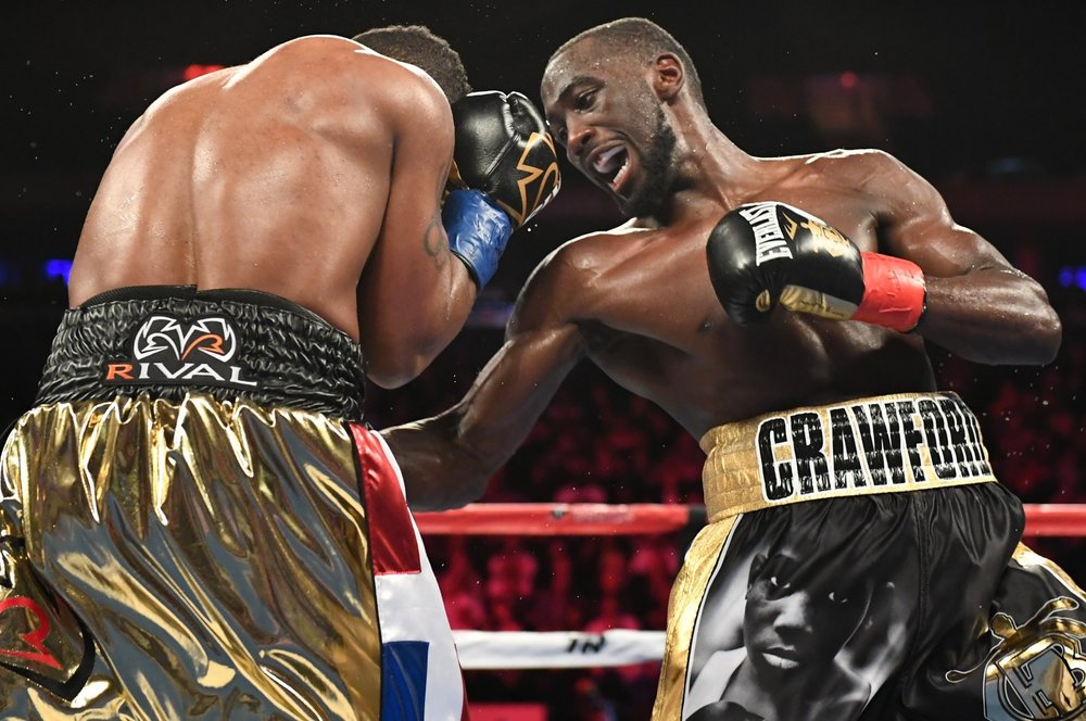 Terence Crawford lands a body shot on Felix Diaz. Photo: Ed Mulholland/HBO Sports