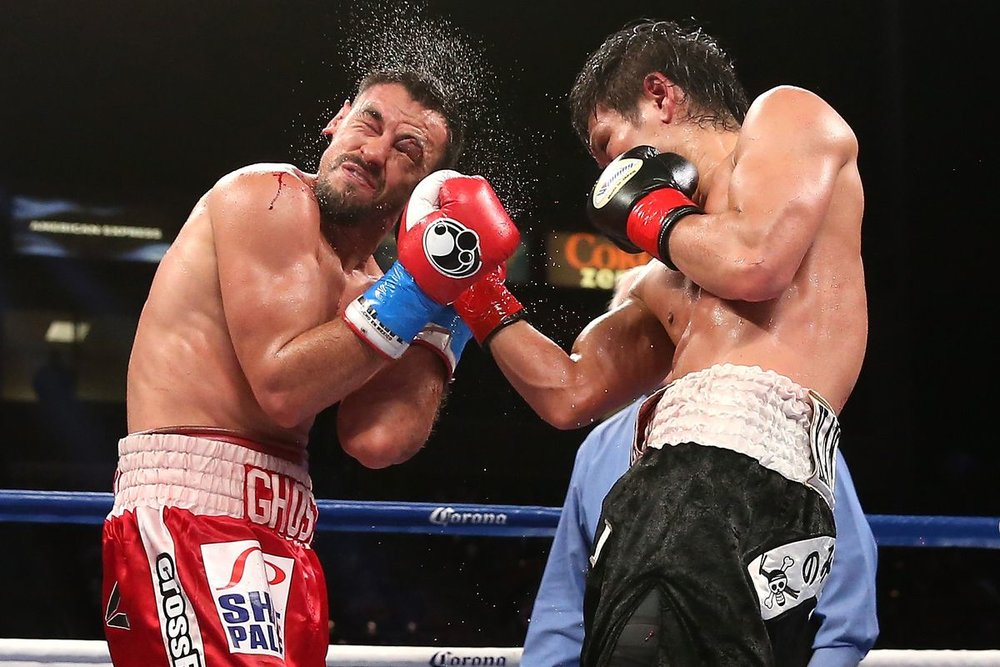 Yoshihiro Kamegai lands an uppercut on Robert Guerrero. Photo: Stephen Dunn/Getty Images