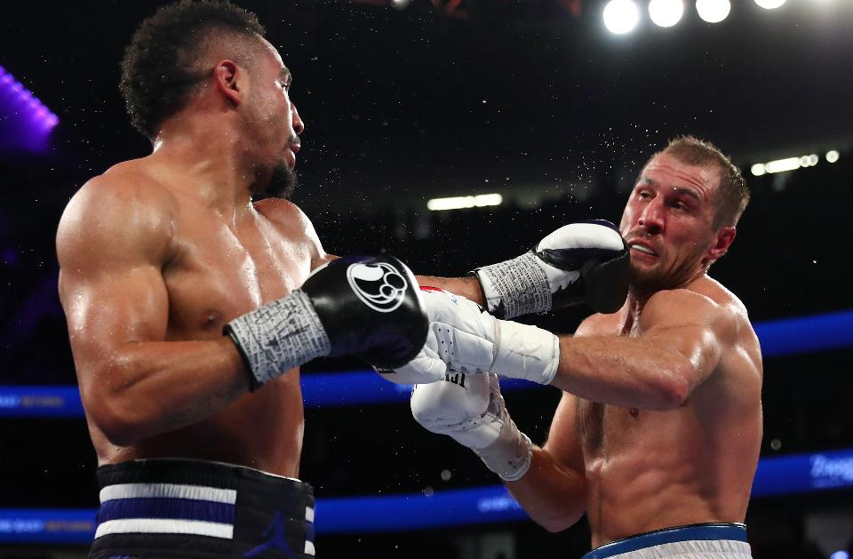 Andre Ward and Sergey Kovalev trade punches in an exchange in their first bout. Photo: Al Bello/Getty Images