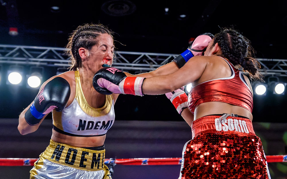 Noemi Bosques and Sonia Osorio trade punches in an action-packed bout. Photo: Joseph Correa/Frontproof Media