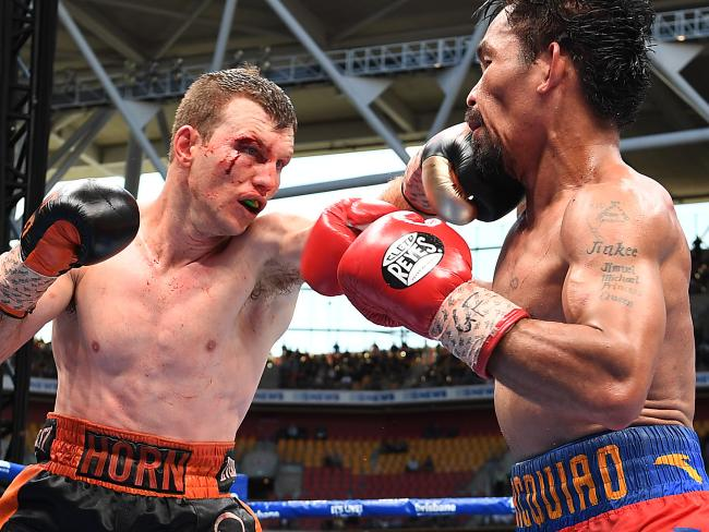 Jeff Horn lands a stiff Jab to the chin of Manny Pacquiao during their fight in Australia. Photo Credit: AAP