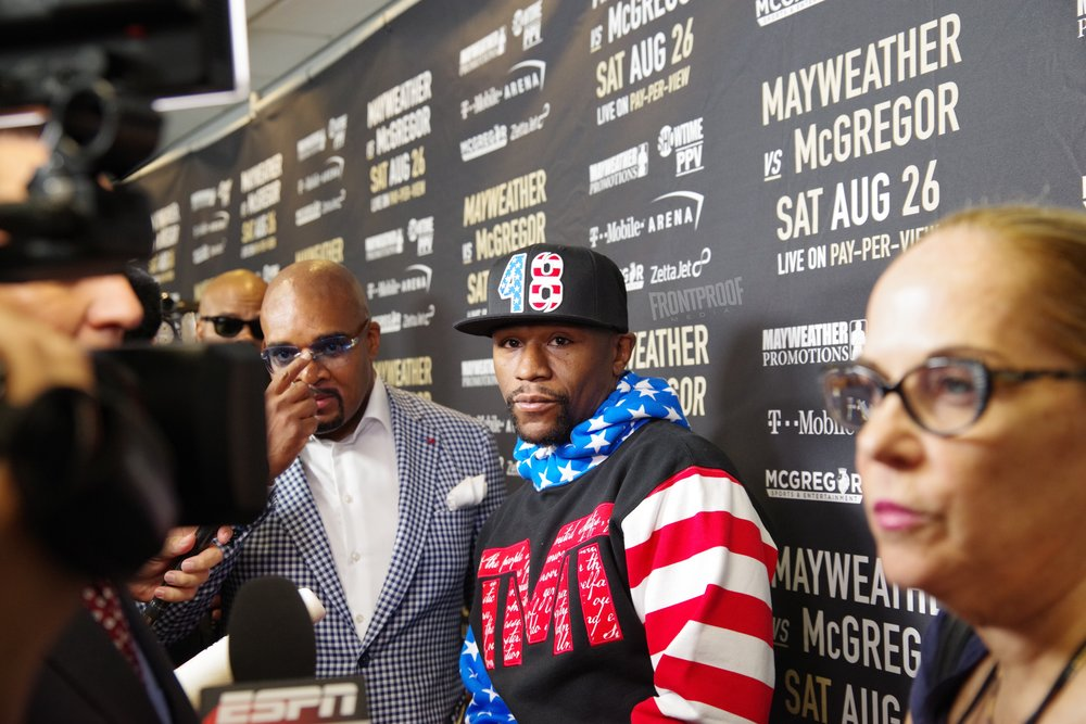 Floyd Mayweather speaks to the media before the public press conference begins in Los Angeles. Photo: Luis Mejia/Frontproof Media