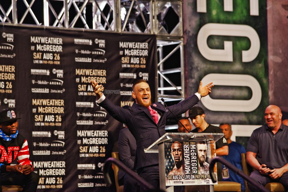 Conor McGregor embraces the cheers from the Los Angeles' crowd before giving his remarks on stage. Photo: Luis Mejia/Frontproof Media