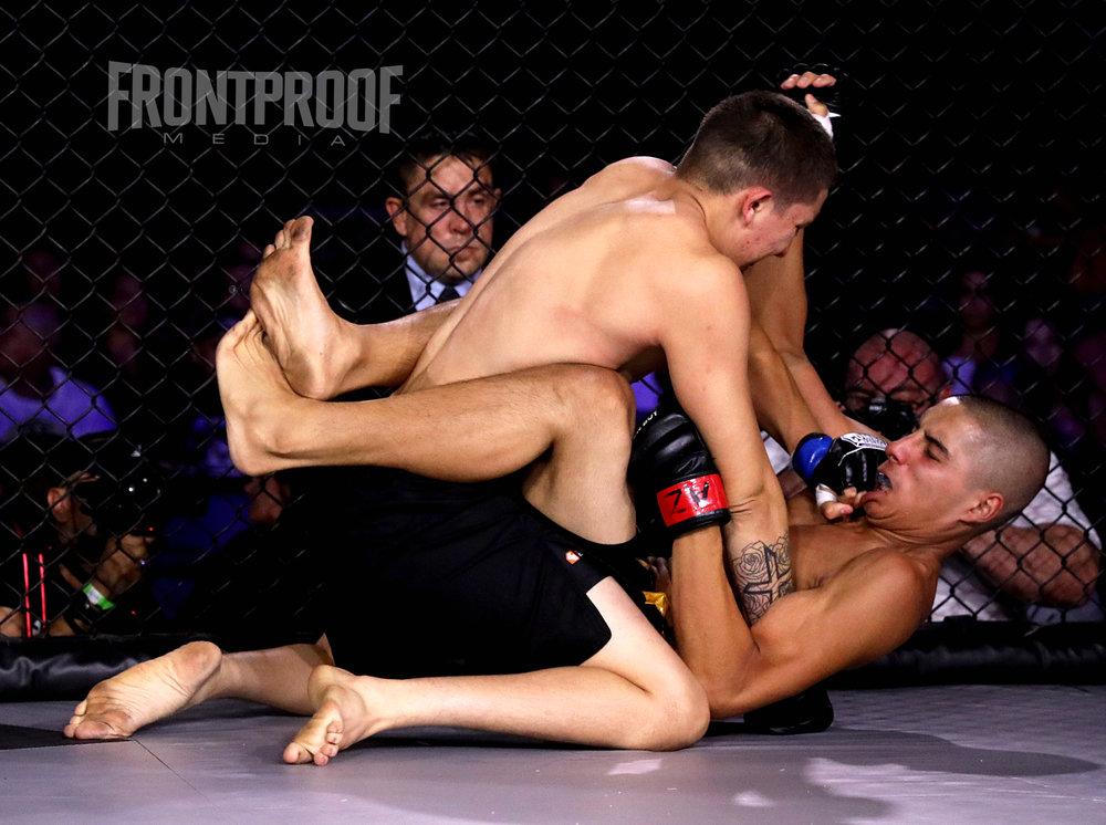 Alex Gomez stops Zack Gomez.Photo: Kelly Owen / Frontproof Media