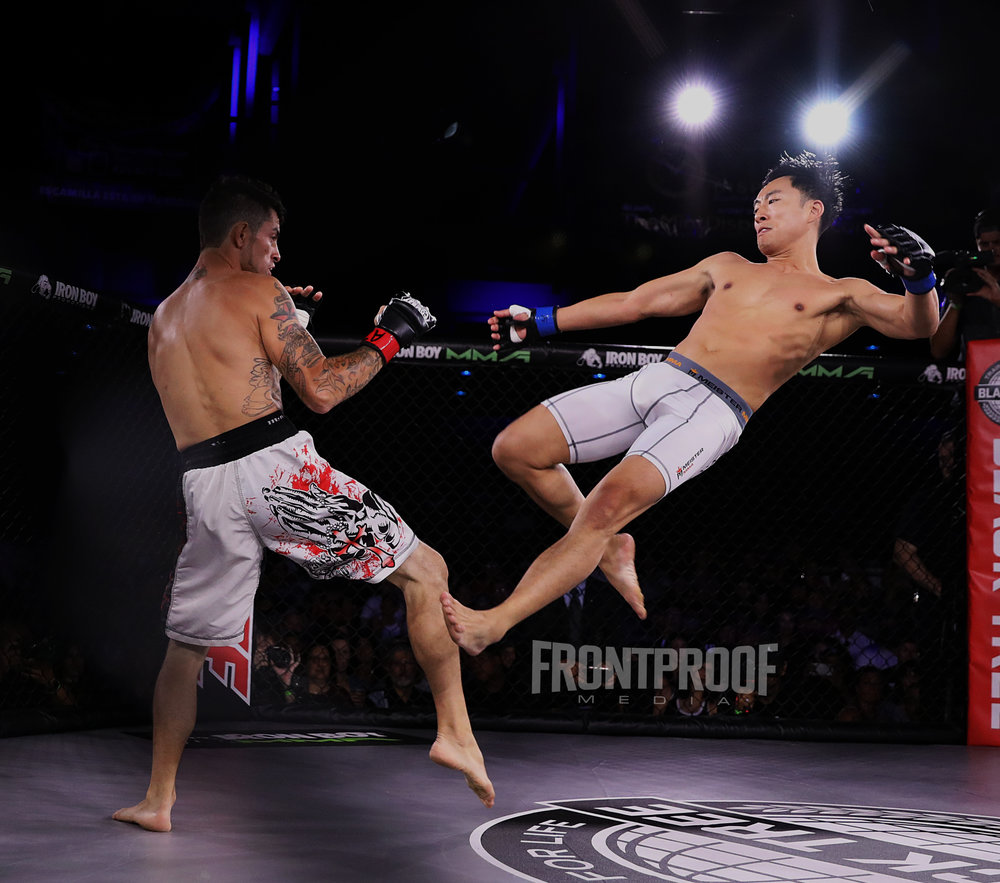 Johnny Ngyuen knocks his opponent Anthony Chavez out with an amazing flying kick. Photo: Kelly Owen / Frontproof Media