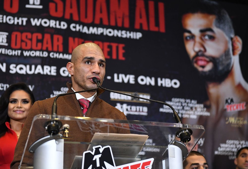 Miguel Cotto addresses media questions at the final press conference. Photo:   Tom Hogan/Hogan Photos/Golden    Boy Promotions