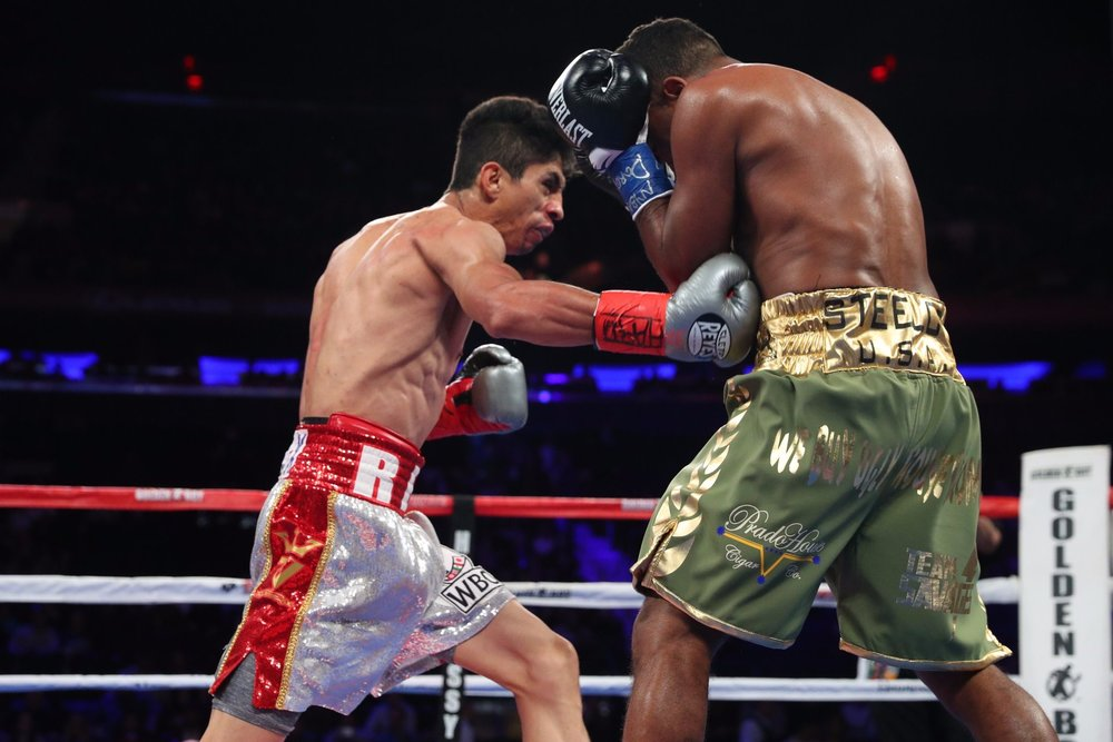 Rey Vargas won a unanimous decision over Oscar Negrete to retain his WBC 122-pound title. Photo: Ed Mulholland/HBO