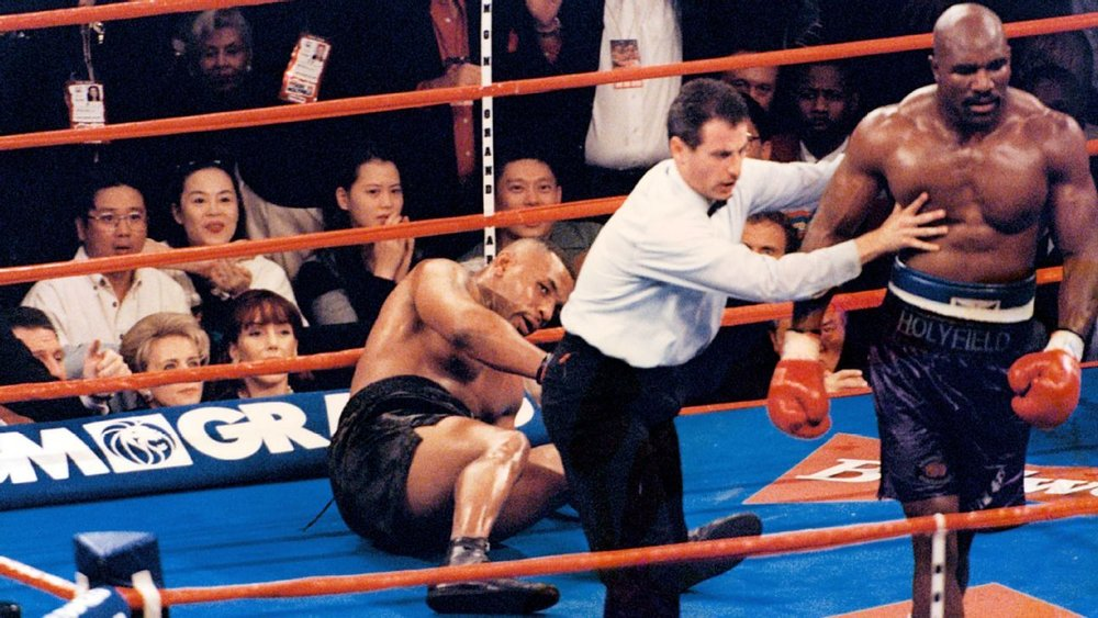 Evander Holyfield stopped Mike Tyson in the 11th round in their first encounter on November 09, 1996. Photo: The Ring Magazine/Getty Images