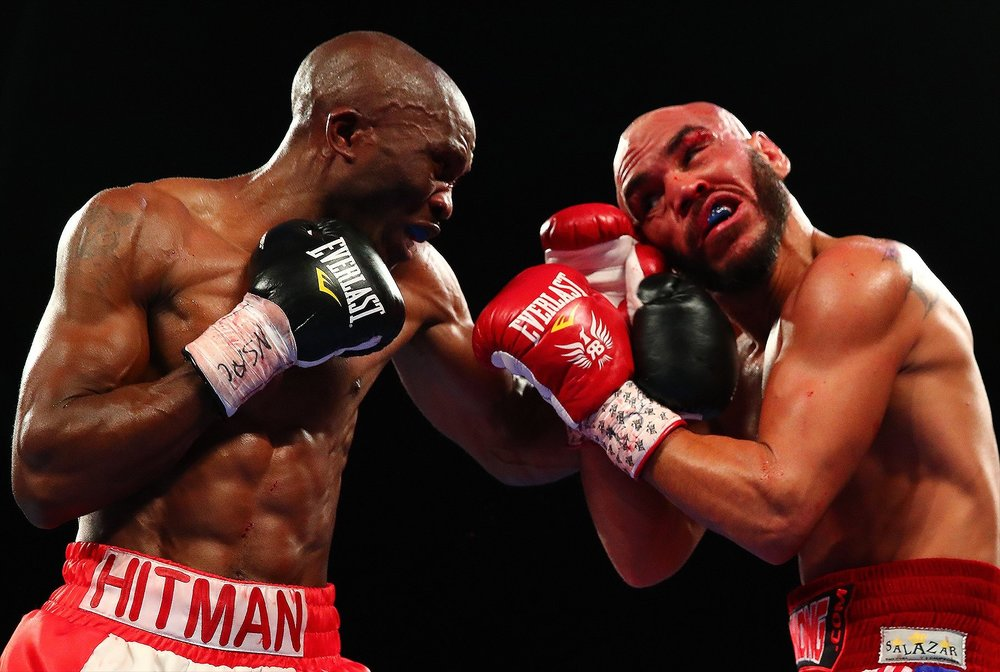 Paulus Moses lands a left hook in an exchange with Ray Beltran. Photo: Top Rank Boxing