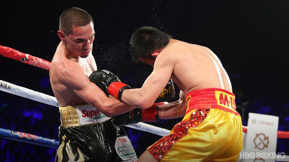 Juan Francisco Estrada lands a well placed body shot on Srisaket Sor Rungvisai. Photo: HBO Boxing