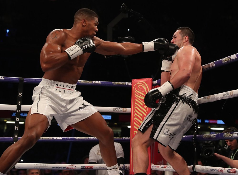 Anthony Joshua backs up Joseph Parker with his jab. Photo: Matchroom Boxing