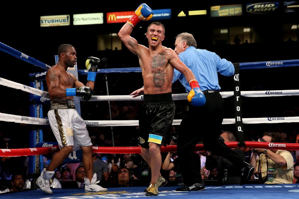 Vasyl Lomachenko celebrating after the final bell in his bout with Gary Russell Jr. for the vacant WBO featherweight title. Photo: Stephen Dunn