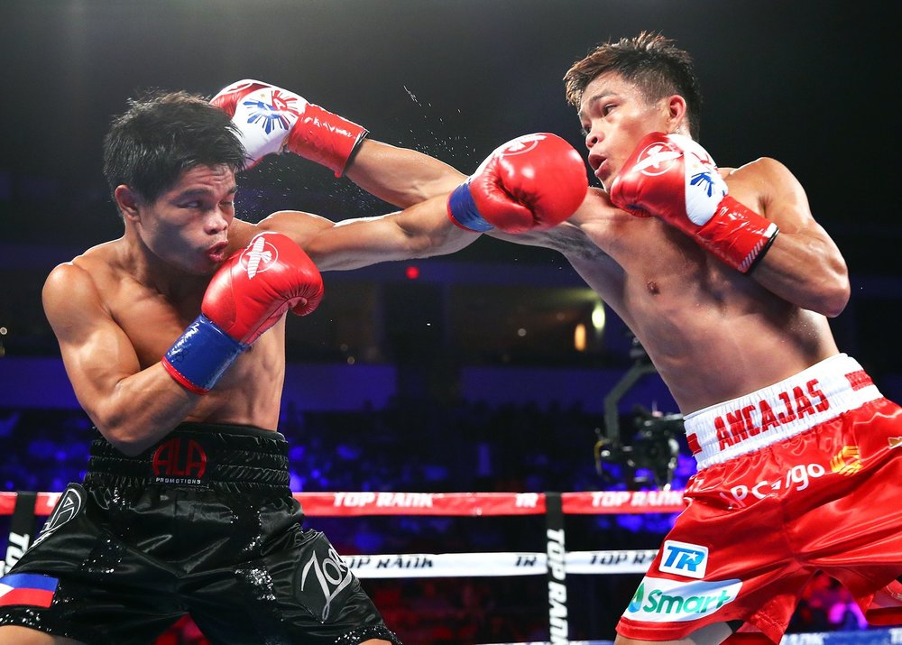Jerwin Ancajas and Jonas Sultan trade punches. Photo: Top Rank Boxing
