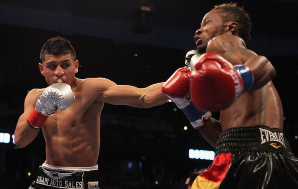 Abner Mares lands a left jab on Joseph Agbeko in their rematch. Photo: Showtime Sports