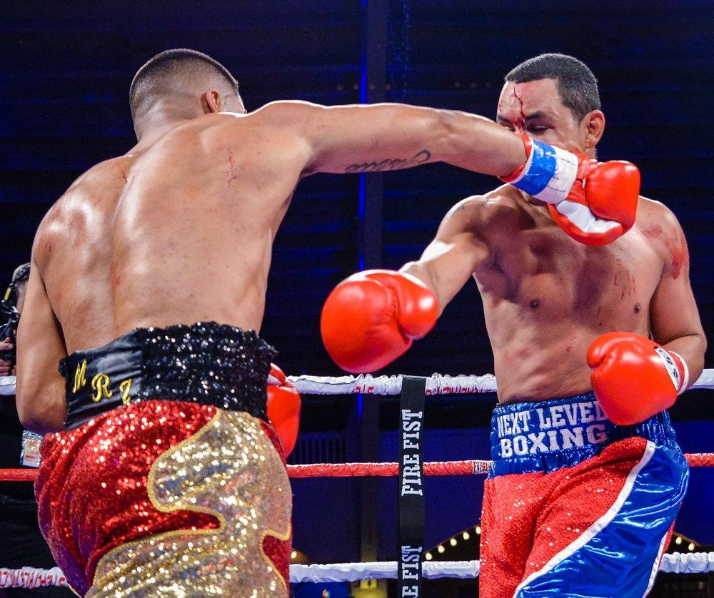 Mark Reyes Jr. lands a right hand on Javier Garcia. Photo: Joseph Correa/Frontproof Media