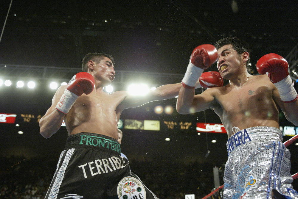 Erik Morales and Marco Antonio battled in a much more technical bout in their rematch in June 2002. Photo: Jed Jacobsohn/Getty Images